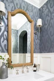 gray and silver ikat wallpaper with wood arch mirror