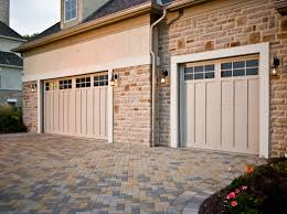 fatezzi faux wood garage doors 9x8 haas american tradition carriage doors in bronze with wrought