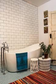 bathroom dark bathroom with white freestanding tub also wooden