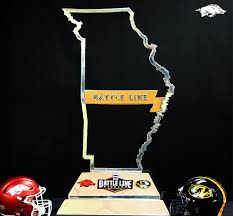 thanksgiving college football games battle line rivalry trophy unveiled for annual mizzou arkansas