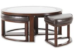 round contemporary cocktail table in dark merlot mathis brothers