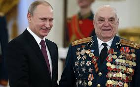 vladimir putin military vladimir putin gives decorated russian tank colonel another medal
