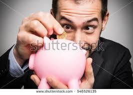 his and piggy bank businessman putting money his piggy bank stock photo 546526135