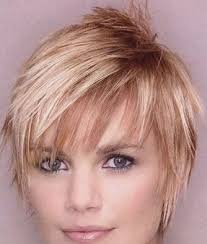 layered long haircut with height on top short hip hairstyle with individually styled wisps that create