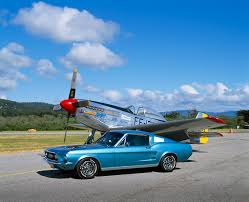 sky blue mustang 1965 ford mustang fastback aqua 3 4 side view on pavement by