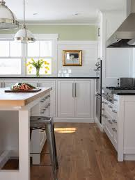 satin nickel white kitchen love everything about this beautiful l shaped kitchen with white shaker cabinets paired with