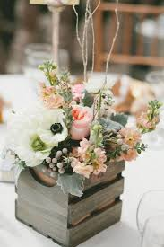 picture of a wooden crate with fresh flowers is a simple and cute idea
