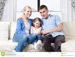 happy family hug each other on sofa stock image image 26751841