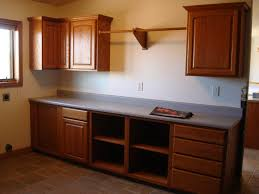 one line brown wooden kitchen cabinet with storage and shelves