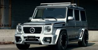 lowered mercedes mercedes g class with air suspension lowers itself onto wald body