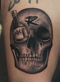 black and gray skull with bottle on eye