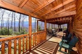 556 thissa way smoky mountain cabin for sale gatlinburg tennessee the second level of the home features another bedroom with tall beamed wooden ceilings and direct access to the second story wrap around porch