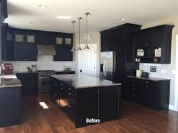 white kitchen cabinets with black island black kitchen cabinets and floors thermofoil kitchen cabinets