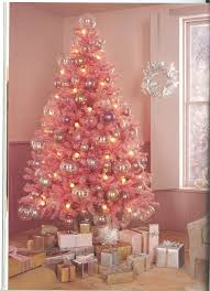 pink startmas tree topperpink lights and blue skirts