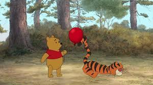 image winnie pooh tells tigger red balloon