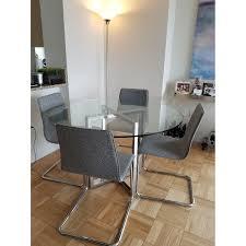 silverado chrome 47 round dining table cb2 silverado glass chrome table w 4 grey tweed chairs aptdeco
