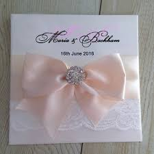 lace wedding invitations with a big ribbon bow