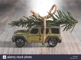 jeep christmas tree suv car toy with christmas tree on roof stock photo royalty free