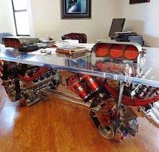 awesome desk build with glass and car engine finding desk