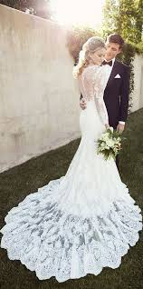 picture of long sleeve mermaid wedding dress with a sheer and lace