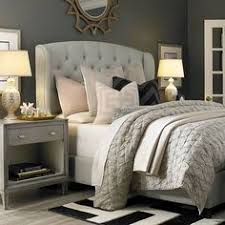 light grey tufted headboard cozy bedroom with tufted upholstered bed neutral light grey linens