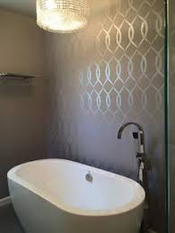 bathroom accent wall ideas a diy silver and gray stenciled accent wall in a bathroom