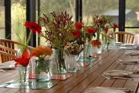 dining room various beautiful flowers in glass jar as the dining