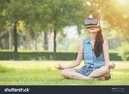 beautiful asian woman enjoy zen virtual reality sitting on grass