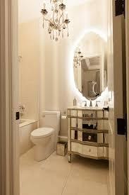 gray bathroom vanity with mirrored doors transitional bathroom