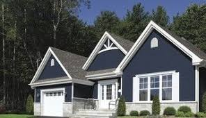 Blue House White Trim | dark blue house with white porch and trim digging the dark blue