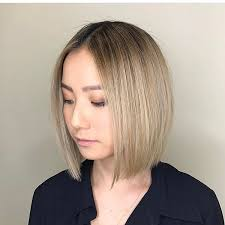 blunt cuts for fine hair women s long blunt bob with front layers and blonde ombre color