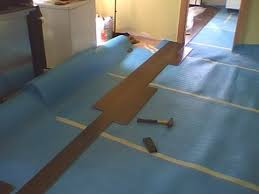 installing laminate flooring flowing between rooms without a t