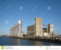 large old rundown cement factory along the water royalty free