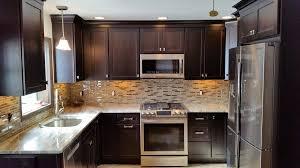 glass tile backsplash with dark cabinets kitchen remodeling the renovation company
