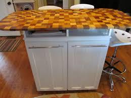 repurposed kitchen cabinet used to hide trash bins repurposed