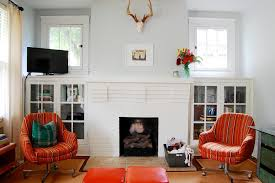painted brick fireplace living room mediterranean with colorful