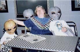 Stoned Alien Meme - lifesize alien doll on the hunt