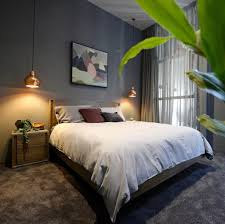 bedroom with grey color and hanging copper pendant bedside lamps