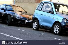 electric porsche 911 porsche 911 sports car and g whizz electric city car parked