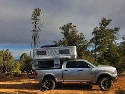 nissan titan camper raptor camper pop up on the road pinterest camping truck