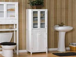 bathroom storage options white wooden cabinet with glass window