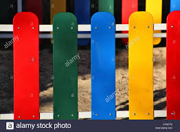 wooden fence painted in bright colors stock photo royalty free