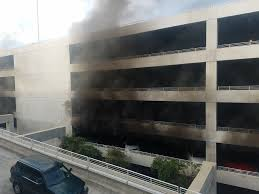 fire in disneyland parking structure leaves 4 workers hospitalized you guys im dead ass serious there is a fire in one of the disneyland