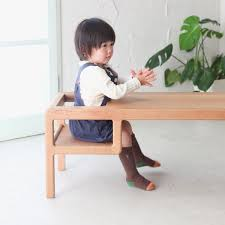 a table with built in baby seat by toa ringyo