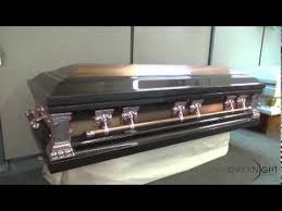 overnight caskets heritage bronze finish with white interior casket