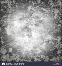 shades of gray color art grunge vintage paper textured stained background with inkblots