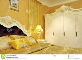 Yellow Bedroom Yellow Shining Bedding And Bedroom Furniture Royalty Free Stock
