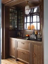 cerused oak kitchen cabinets in a wood clad alcove light brown cerused oak bar cabinets are