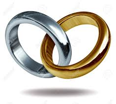 linked wedding rings wedding rings linked together to form a golden and titanium shape