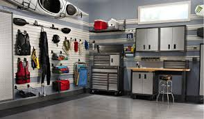 garage forvaring sok p google skona hemma prylar pinterest this watersport enthusiast has perfected a storage and workspace solution for this garage how could you adjust your garage space to fit your passion